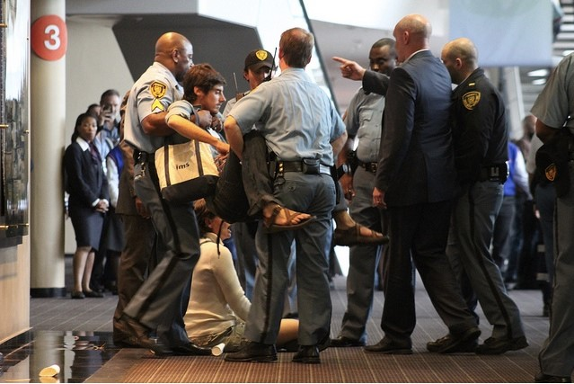 GJEP is removed by UN security during sit-in occupation. Photo: Ben Powless