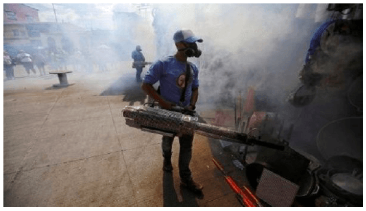Municipal worker fumigates a market to prevent the spread of dengue fever in Tegucigalpa, Honduras, July 25, 2019.
